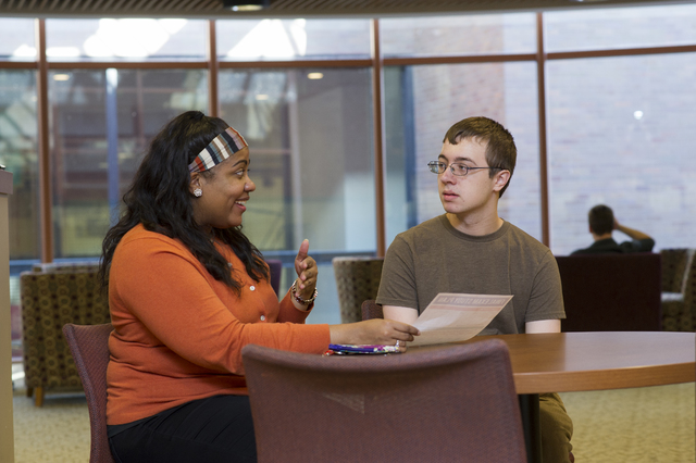 Freshman Nathan Terrell, who has autism, meets with his mentor Atiya Smith, a licensed therapist and doctoral student in counseling at the University of Rochester. Thanks to the Spectrum Support P ...