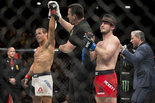 Urijah Faber, left, is called the winner against Brad Pickett in the UFC Fight Night bantamweight bout at the Golden 1 Center on Saturday, Dec. 17, 2016, in Sacramento, Calif. Faber won by unanimo ...