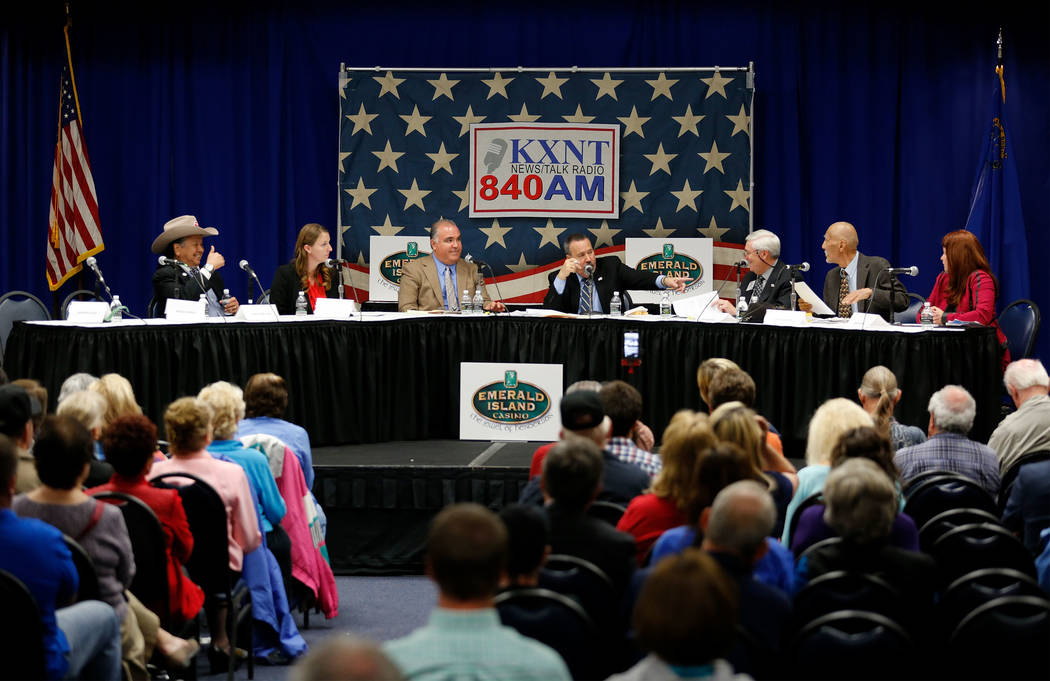 Henderson mayoral candidates Eddie Hamilton, from left, Crystal Hendrickson, moderators Tim Brooks, owner of the Emerald Island Casino, KXNT radio host Alan Stock, other mayoral candidates Rick Wo ...