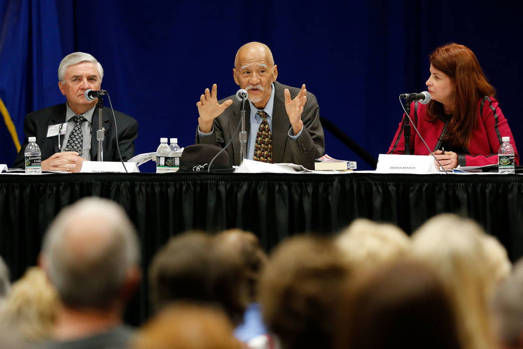 Henderson mayoral candidate Jerry Sakura, center, speaks during a debate-forum at the Henderson Convention Center, Monday, March 27, 2017, in Henderson, as other candidates Rick Workman, left, and ...