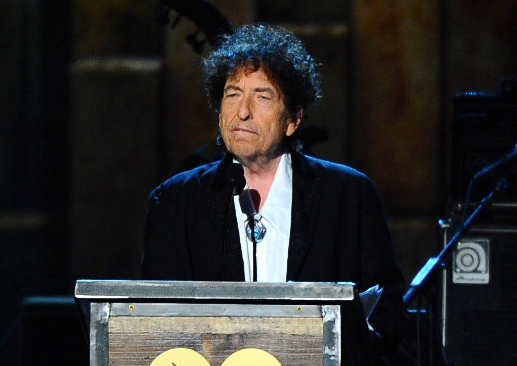 FILE - In this Feb. 6, 2015 file photo, Bob Dylan accepts the 2015 MusiCares Person of the Year award at the 2015 MusiCares Person of the Year show in Los Angeles. In a rare and lengthy interview, ...
