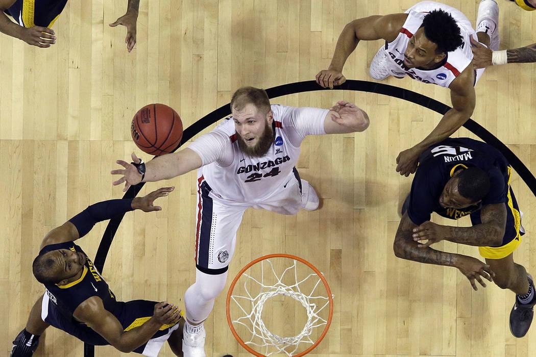 Gonzaga center Przemek Karnowski, center, grabs a rebound against West Virginia during an NCAA Tournament college basketball regional semifinal game Thursday, March 23, 2017, in San Jose, Calif. ( ...