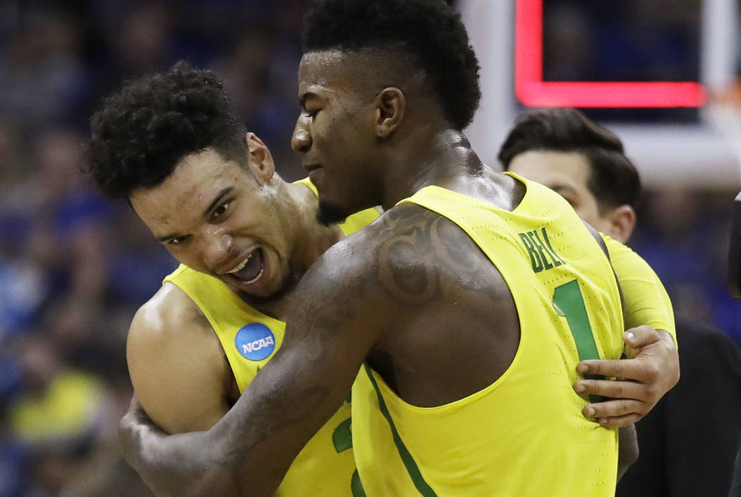 Oregon forward Dillon Brooks, left, celebrates with Jordan Bell after a regional semifinal against Michigan in the NCAA men's college basketball tournament, Thursday, March 23, 2017, in Kansas Cit ...