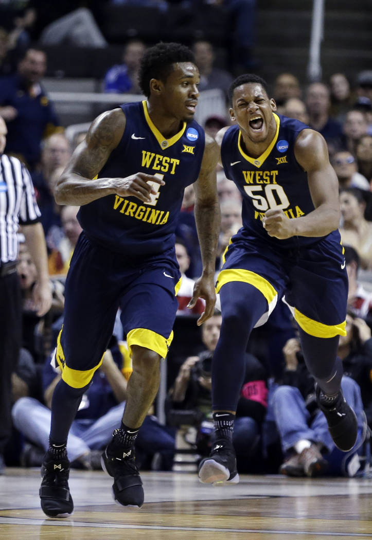 West Virginia forward Sagaba Konate (50) celebrates after scoring against Gonzaga during the second half of an NCAA Tournament college basketball regional semifinal game Thursday, March 23, 2017,  ...