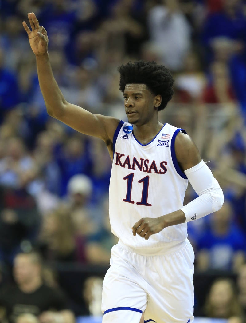 Kansas guard Josh Jackson celebrates after making a 3-point basket during the first half against Purdue in a regional semifinal of the NCAA men's college basketball tournament, Thursday, March 23, ...