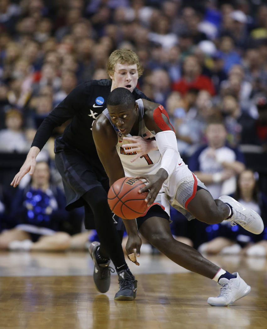 Xavier guard J.P. Macura, left, defends on Arizona guard Rawle Alkins (1) during the first half of an NCAA Tournament college basketball regional semifinal game Thursday, March 23, 2017, in San Jo ...
