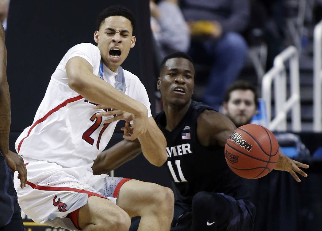 Arizona center Chance Comanche (21) works against Xavier guard Malcolm Bernard (11) during the first half of an NCAA Tournament college basketball regional semifinal game Thursday, March 23, 2017, ...