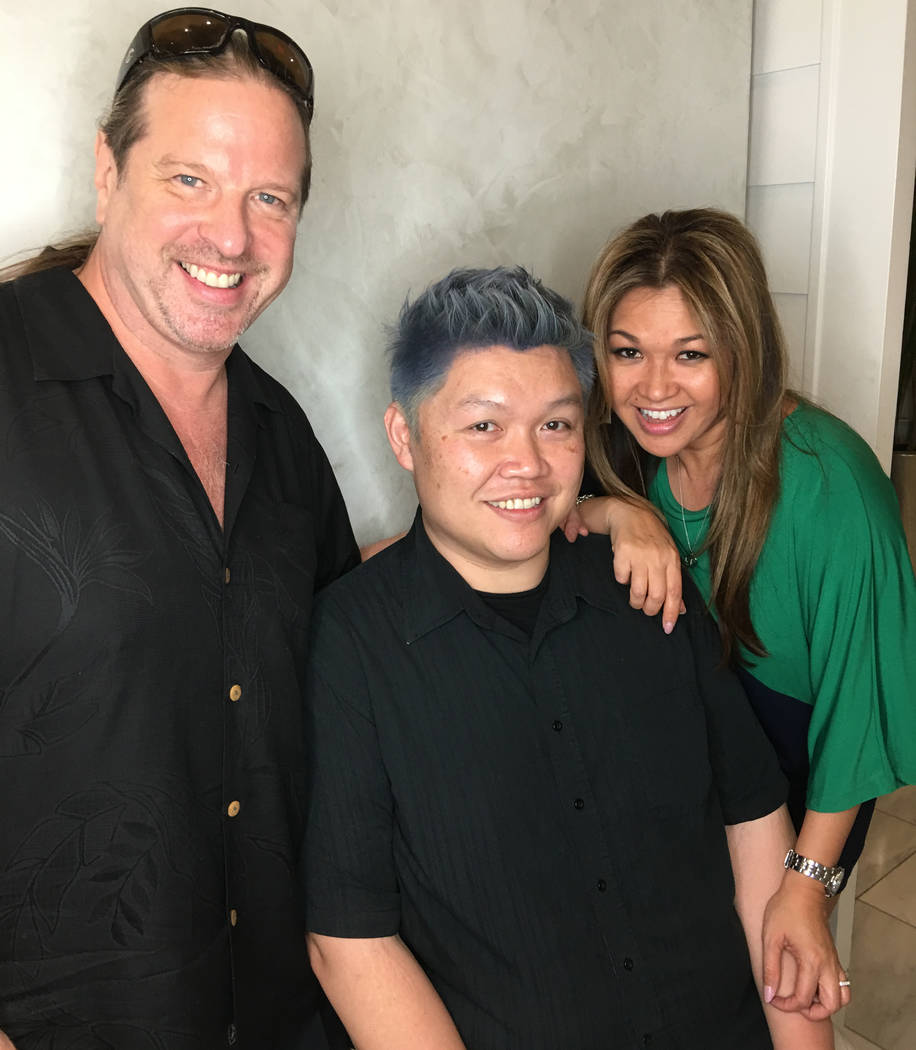 Don Chareunsy, center, with Michael Boychuck and Davone Philavong, with newly blue hair at Color, a Salon by Michael Boychuck, at Caesars Palace on Friday, March 17, 2017, in Las Vegas.