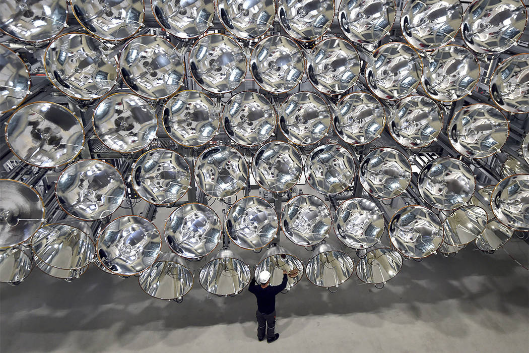 In this March 21, 2017 photo engineer Volkmar Dohmen stands in front of xenon short-arc lamps in the DLR German national aeronautics and space research center in Juelich, western Germany. The ligh ...