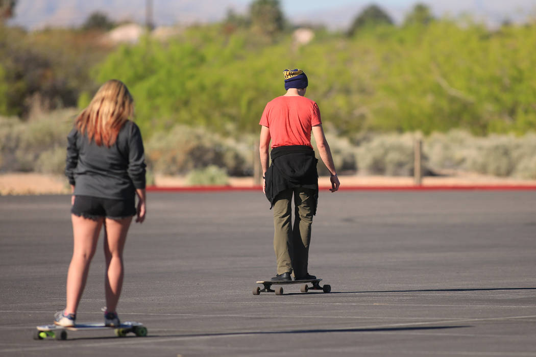 Skaters tool around in a parking lot on long boards at Sunset Park in Las Vegas on Friday, March 24, 2017. (Brett Le Blanc/Las Vegas Review-Journal) @bleblancphoto