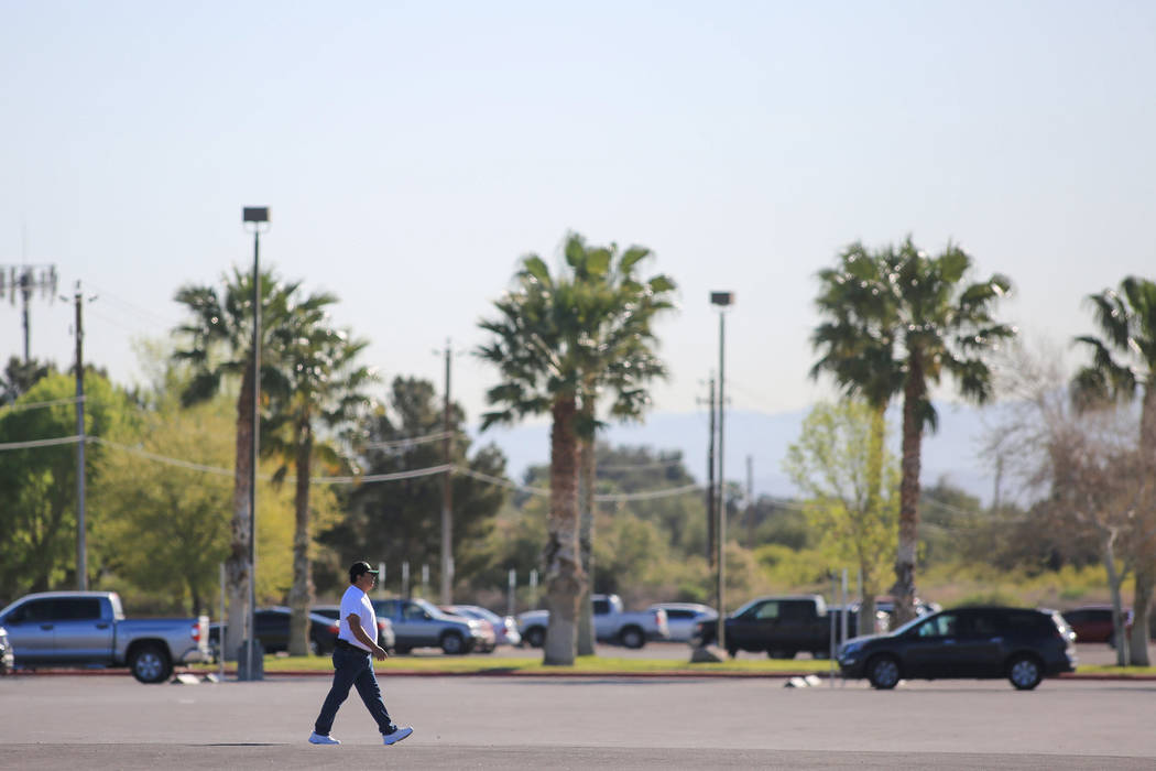 A man walks across a parking lot at Sunset Park in Las Vegas on Friday, March 24, 2017. (Brett Le Blanc/Las Vegas Review-Journal) @bleblancphoto