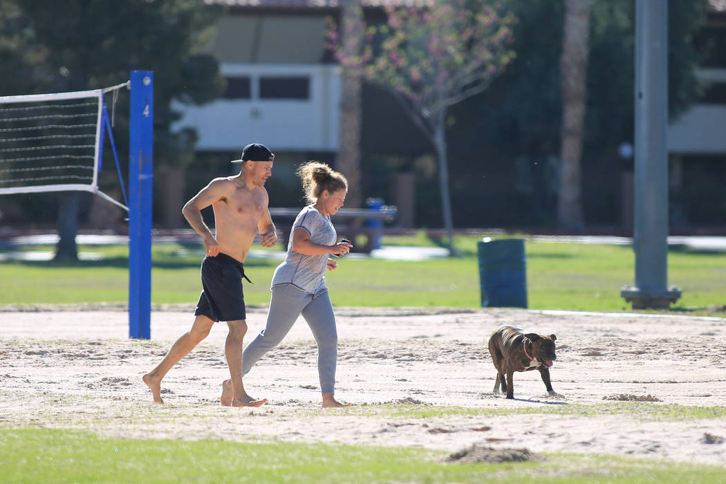 Joggers get in exercise in the sand of volleyball courts at Sunset Park in Las Vegas on Friday, March 24, 2017. (Brett Le Blanc/Las Vegas Review-Journal) @bleblancphoto
