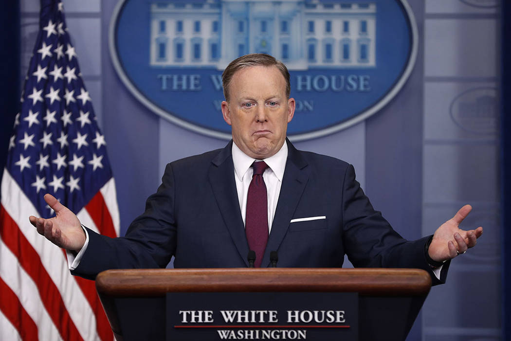 White House press secretary Sean Spicer gestures as he speaks to the media during the daily briefing in the Brady Press Briefing Room of the White House in Washington, Friday, March 24, 2017. (AP  ...