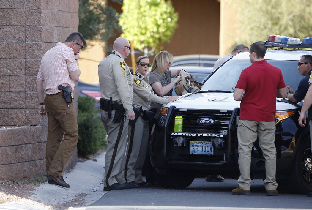 Las Vegas Metropolitan police officers are investigating a shooting near the 10200 block of Yarmouth Sea Ct. on Friday, March 17, 2017, in Las Vegas. (Christian K. Lee/Las Vegas Review-Journal) @c ...