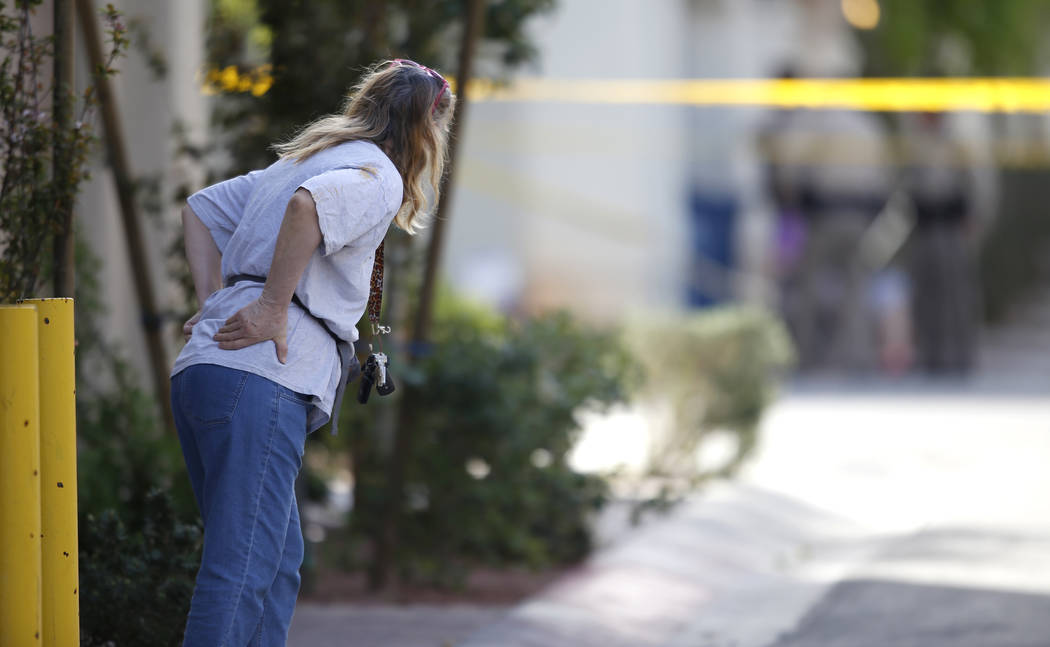 A neighbor near the 10200 block of Yarmouth Sea Ct. looks at a scene where Las Vegas Metropolitan police officers investigate a shooting on Friday, March 17, 2017, in Las Vegas. (Christian K. Lee/ ...