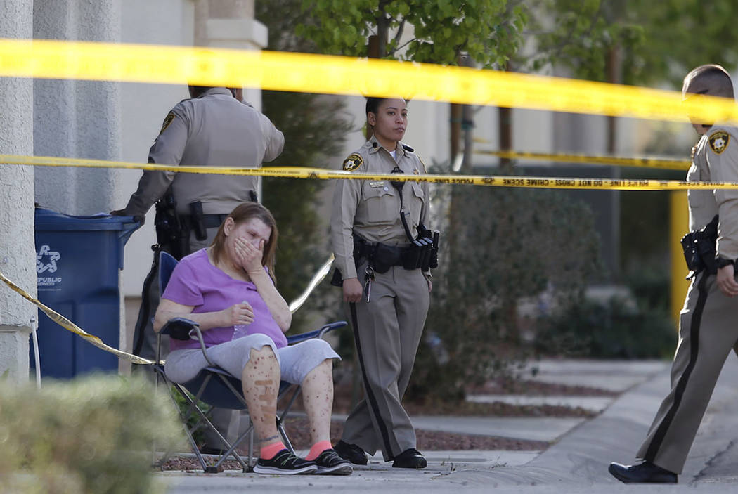 A woman reacts while Las Vegas police officers investigate a shooting near the 10200 block of Yarmouth Sea Ct. on Friday, March 17, 2017, in Las Vegas. (Christian K. Lee/Las Vegas Review-Journal)  ...