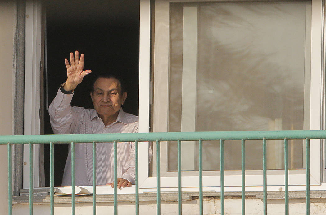 Ousted Egyptian President Hosni Mubarak waves to his supporters from his room at the Maadi Military Hospital as they celebrate the 43rd anniversary of the Oct. 6, 1973 war, Oct. 16, 1016. (Amr Nab ...