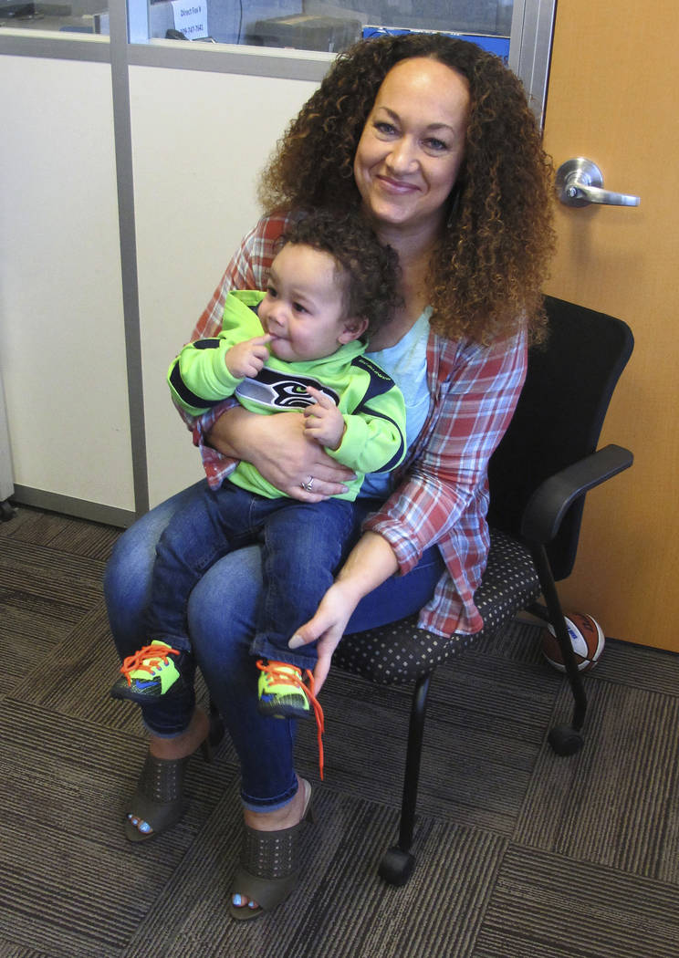 Rachel Dolezal poses for a photo with her son, Langston in the bureau of the Associated Press in Spokane, Wash. (Nicholas K. Geranios/AP)