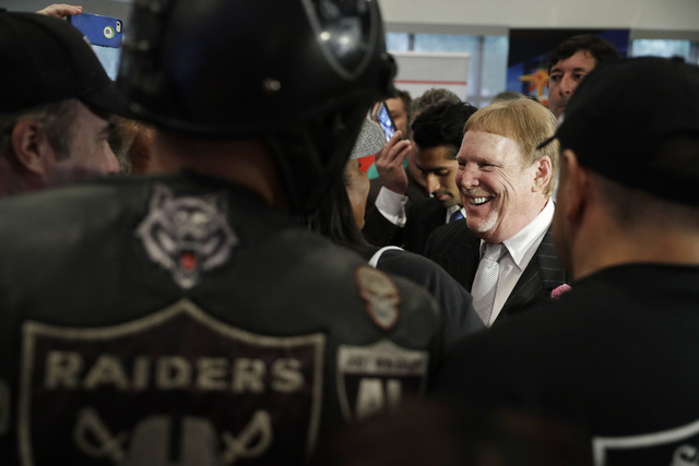 Oakland Raiders owner Mark Davis speaks with fans after a signing ceremony Monday, Oct. 17, 2016, in Las Vegas. Nevada Governor Brian Sandoval signed a bill into law that clears the way for a Las  ...