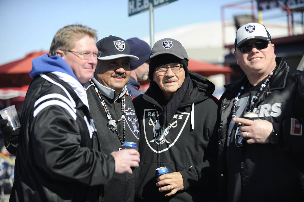 Oakland Raiders fans walk to the stadium before the first half of an AFC Wild Card NFL football game between the Houston Texans and the Oakland Raiders, Saturday, Jan. 7, 2017, in Houston. (AP Pho ...
