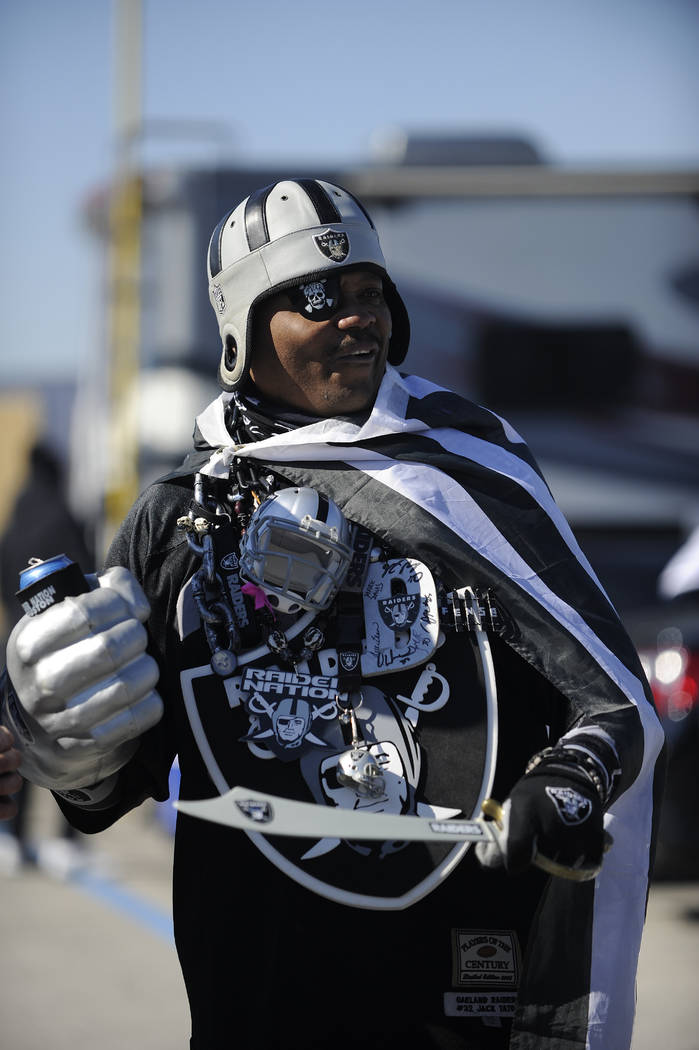 Oakland Raiders fans pose for photos before the first half of an AFC Wild Card NFL football game between the Houston Texans and the Oakland Raiders, Saturday, Jan. 7, 2017, in Houston. (AP Photo/E ...