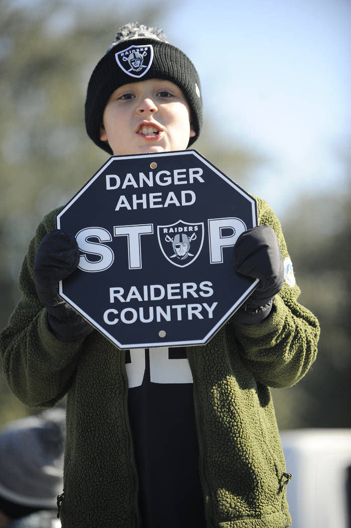 A Oakland Raiders fan poses for a photo before the first half of an AFC Wild Card NFL football game between the Houston Texans and the Oakland Raiders, Saturday, Jan. 7, 2017, in Houston. (AP Phot ...