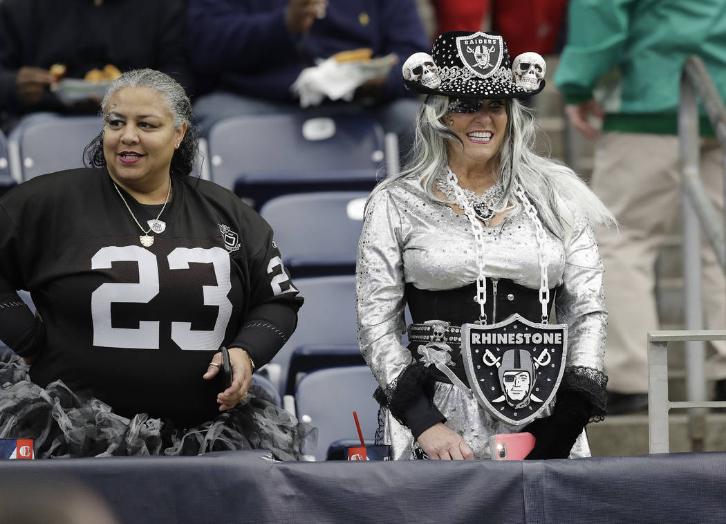 Oakland Raiders fans watch teams warm up before the first half of an AFC Wild Card NFL football game between the Houston Texans and the Oakland Raiders, Saturday, Jan. 7, 2017, in Houston. (AP Pho ...