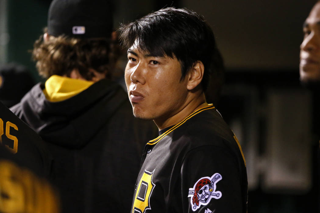 In this Sept. 26, 2016, file photo, Pittsburgh Pirates' Jung Ho Kang stands in the dugout during a baseball game against the Chicago Cubs in Pittsburgh. Kang was placed on the restricted list whil ...