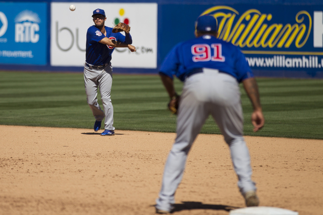 Chicago Cubs Kristopher Negron (19) throws the ball to first base for an out against the New York Mets in their baseball game during Big League Weekend at Cashman Field on Friday, April 1, 2016, i ...