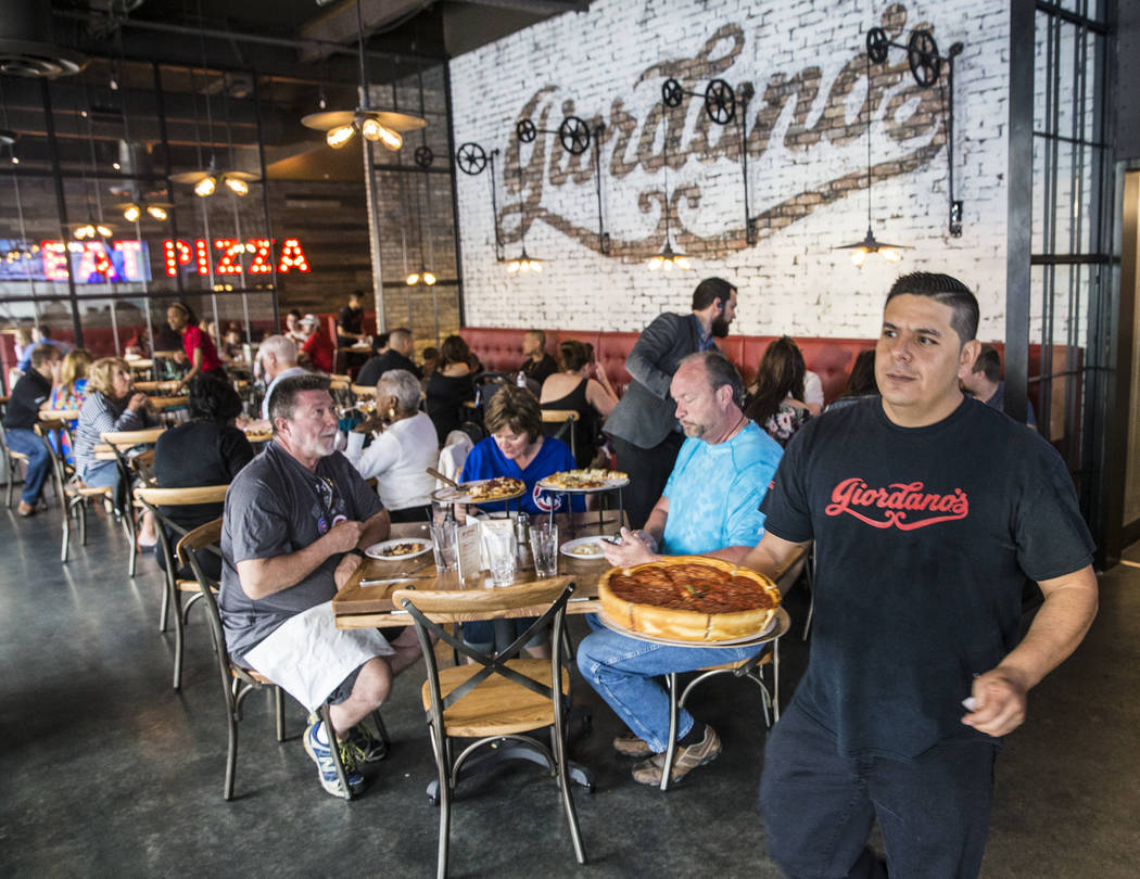 Fresh pizzas come out of the kitchen at Giordano's on Sunday, March 26, 2017, in Las Vegas. (Benjamin Hager/Las Vegas Review-Journal) @benjaminhphoto