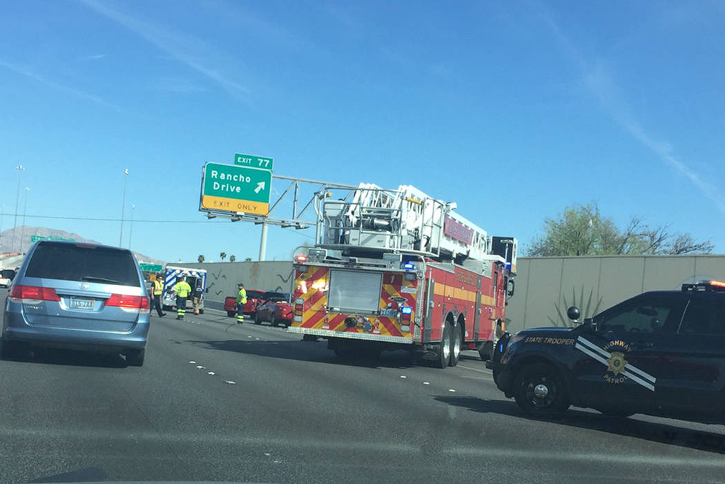 Emergency crews on the scene of an afternoon crash on U.S. 95 that occurred before a second incident in which a pickup struck a Nevada Highway Patrol vehicle. (Las Vegas Review-Journal)