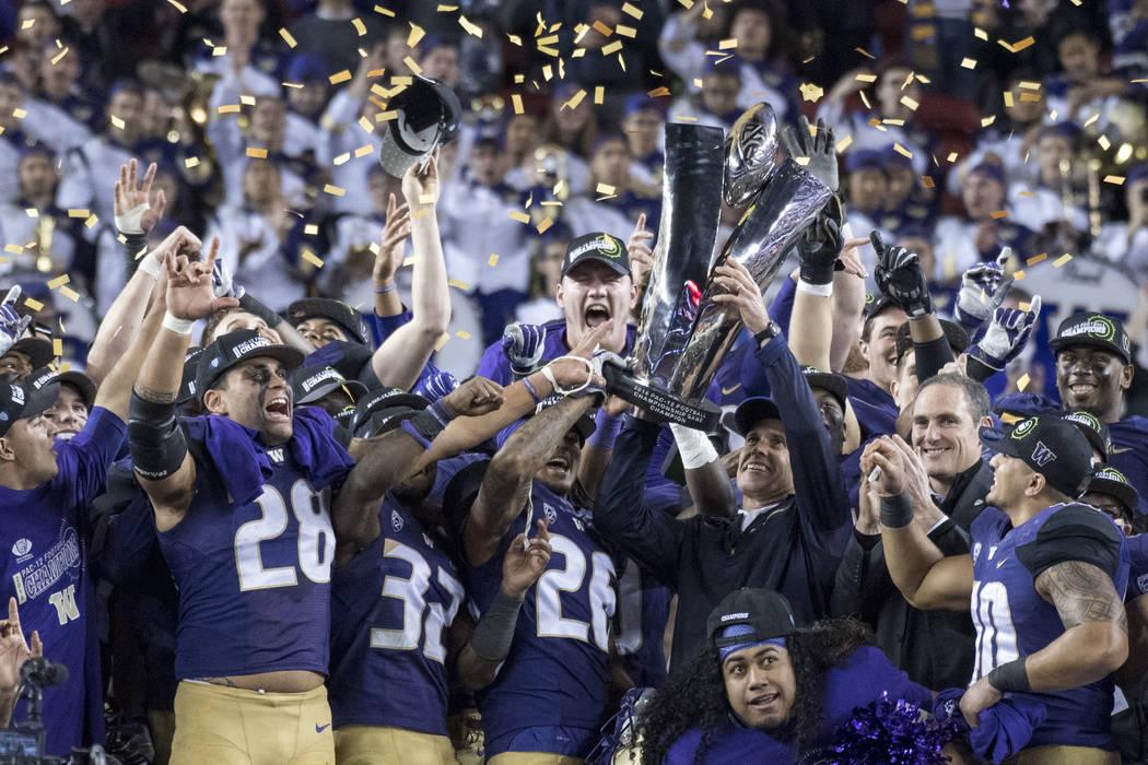 December 2, 2016; Santa Clara, CA, USA; Washington Huskies head coach Chris Petersen hoists the championship trophy after the Pac-12 championship against the Colorado Buffaloes at Levi's Stadium.  ...