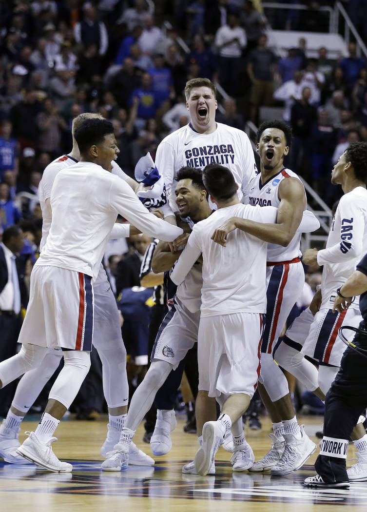 Gonzaga players celebrate after beating West Virginia during an NCAA Tournament college basketball regional semifinal game Thursday, March 23, 2017, in San Jose, Calif. (AP Photo/Ben Margot)