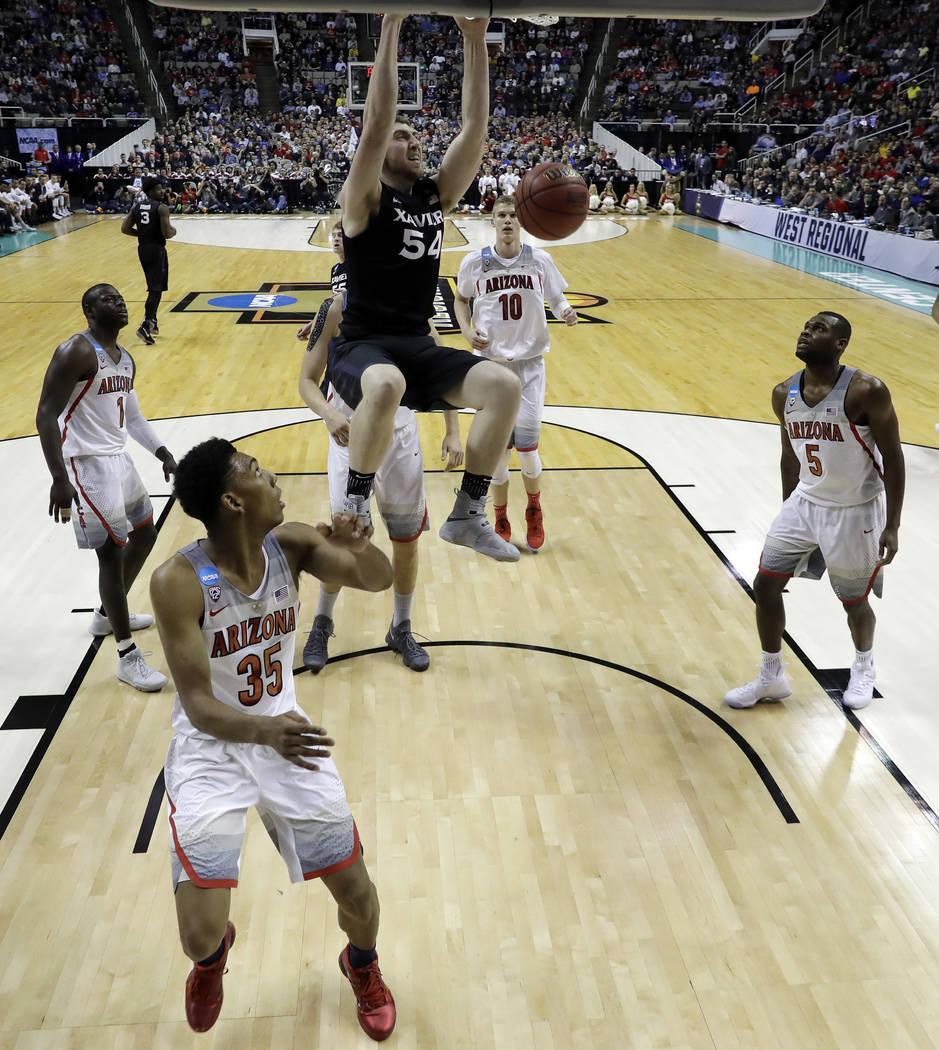 Xavier forward Sean O'Mara (54) dunks against Arizona during the second half of an NCAA Tournament college basketball regional semifinal game Thursday, March 23, 2017, in San Jose, Calif. (AP Phot ...