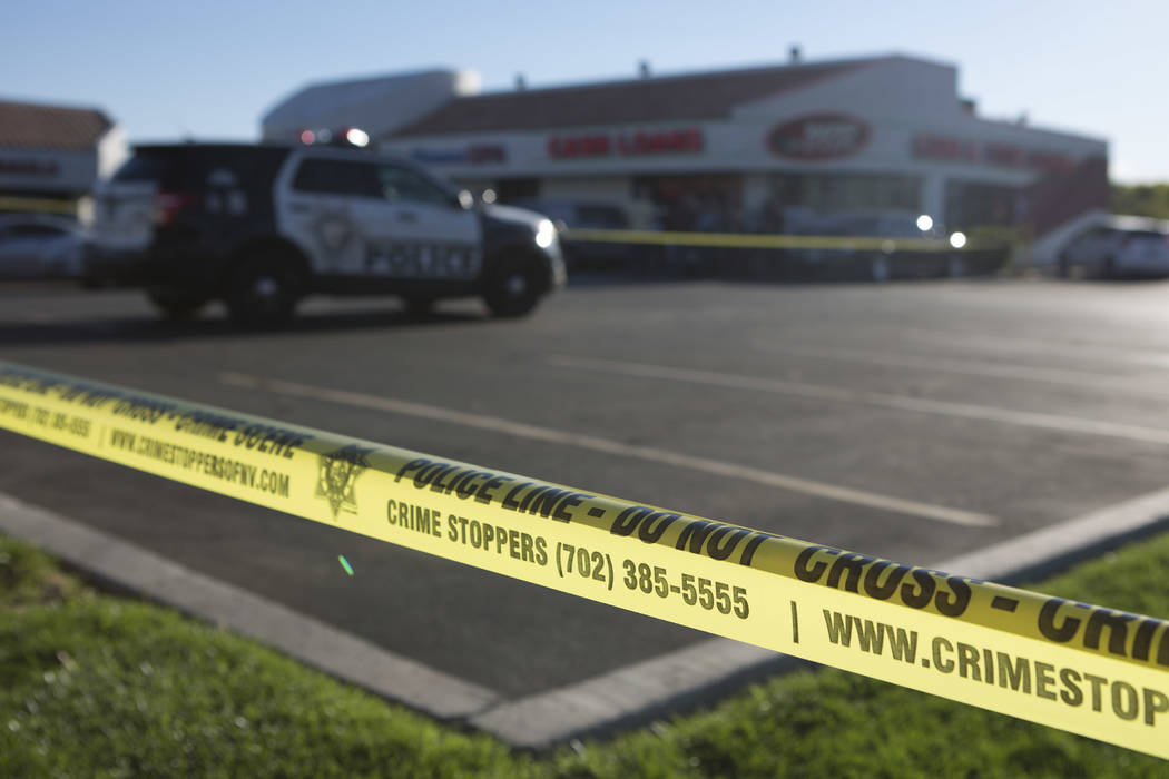 A police line borders a parking lot outside a Rapid Cash, on W. Flamingo Road near Jones Boulevard, where the incident took place in Las Vegas on Friday, March 24, 2017. (Bridget Bennett/Las Vegas ...