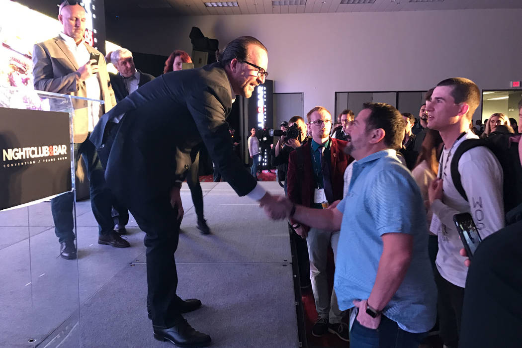Hakkasan CEO Neil Moffitt, left, talks with attendees during the Nightclub and Bar Show at the Las Vegas Convention Center in Las Vegas, Monday, March 27, 2017, after his keynote speech. Moffitt s ...