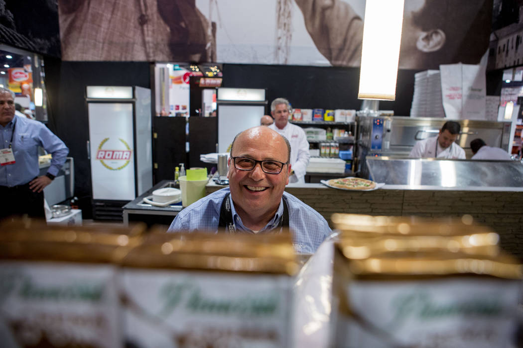 Luigi Sortini with Roma Pizza serves espresso at the International Pizza Expo at the Las Vegas Convention Center in Las Vegas, Tuesday, March 28, 2017. (Elizabeth Brumley/Las Vegas Review-Journal) ...