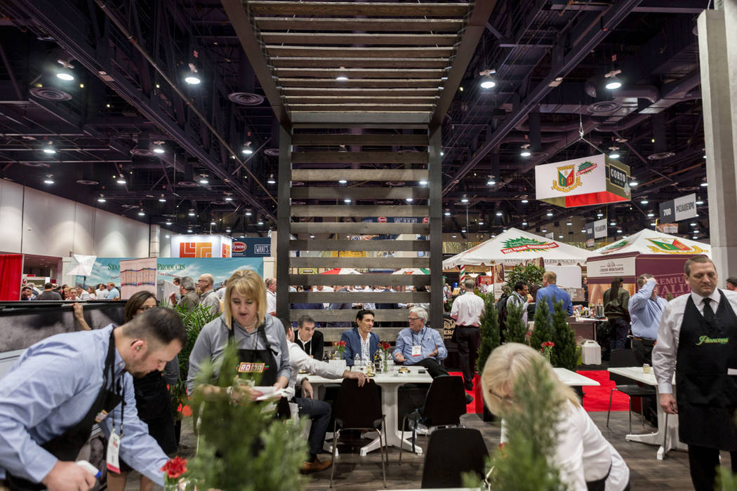 Attendees taste Roma Pizza during the International Pizza Expo at the Las Vegas Convention Center in Las Vegas, Tuesday, March 28, 2017. (Elizabeth Brumley/Las Vegas Review-Journal) @EliPagePhoto