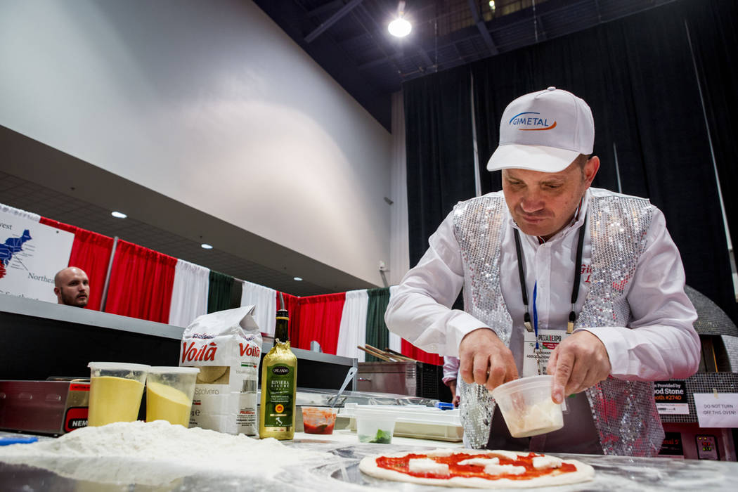 Associazione Mani d'Oro chef Giovannie Landi competes in the International Pizza Competition during the International Pizza Expo at the Las Vegas Convention Center in Las Vegas, Tuesday, March 28, ...