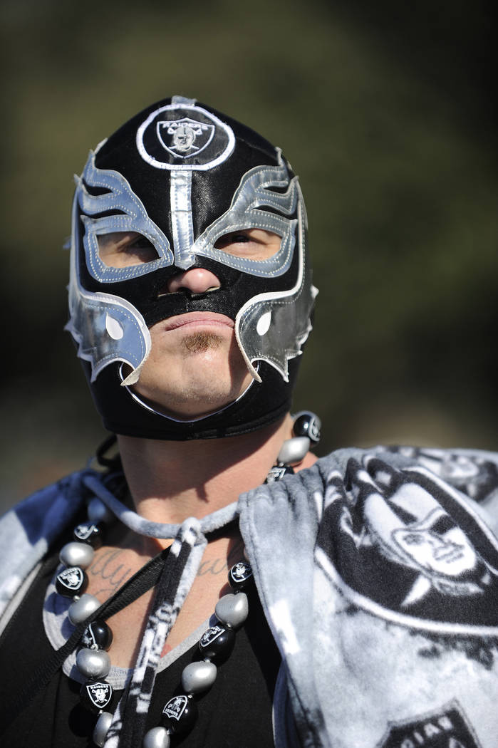 Oakland Raiders fans pose for photos before the first half of an AFC Wild Card NFL football game between the Houston Texans and the Oakland Raiders, Saturday, Jan. 7, 2017, in Houston. (Eric Chris ...