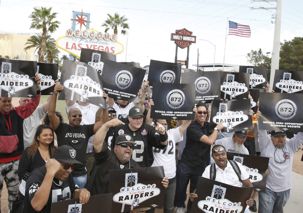 Raiders fans celebrate in Las Vegas after the National Football League owners voted in Phoenix to approve the relocation of the Oakland Raiders to Las Vegas on Monday, 27, 2017. (Bizuayehu Tesfaye ...
