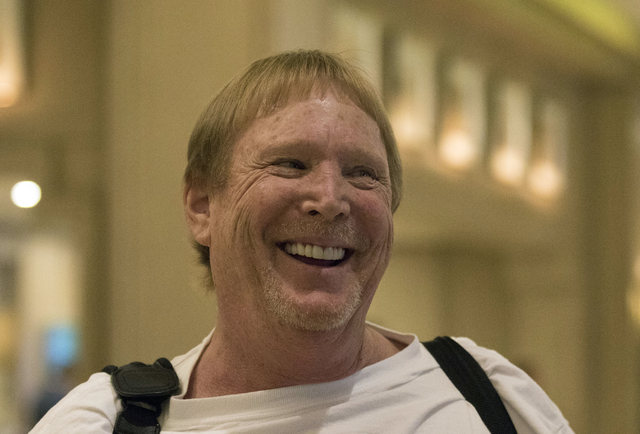 Mark Davis, the owner of the Oakland Raiders, smiles as he is questioned about the plans for the team to move to Las Vegas following a NFL meeting in Irving, Texas, on Dec. 14, 2016. (Heidi Fang/L ...