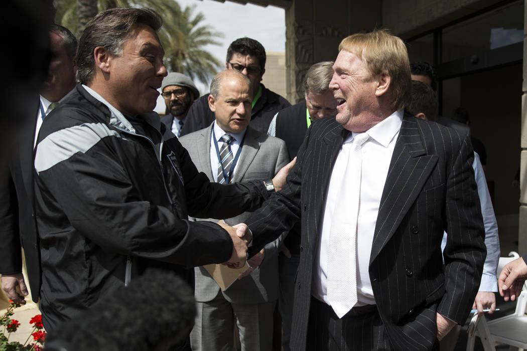 Oakland Raiders owner Mark Davis, right, after the NFL approved the Raiders move to Las Vegas with a 31-1 vote during day two of the NFL Annual Meeting on Monday, March 27, 2017, in Phoenix, Ariz. ...
