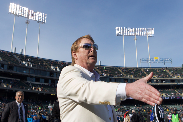 Mark Davis, owner and managing general partner of the Oakland Raiders, talks to current and former players and coaches as he walks around the stadium prior to a game at Oakland Colosseum, Sunday,  ...