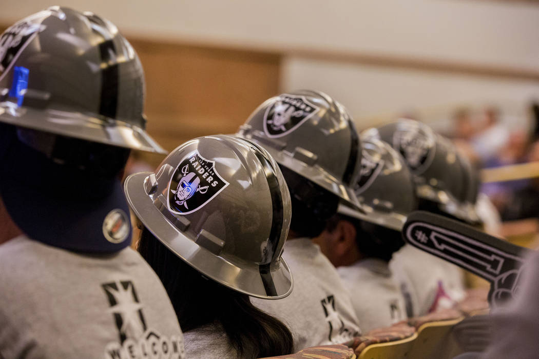 Union workers dress in Las Vegas Raider attire during a Las Vegas Stadium Authority meeting on the status of lease agreement negotiations with the Oakland Raiders at the Clark County Government Ce ...