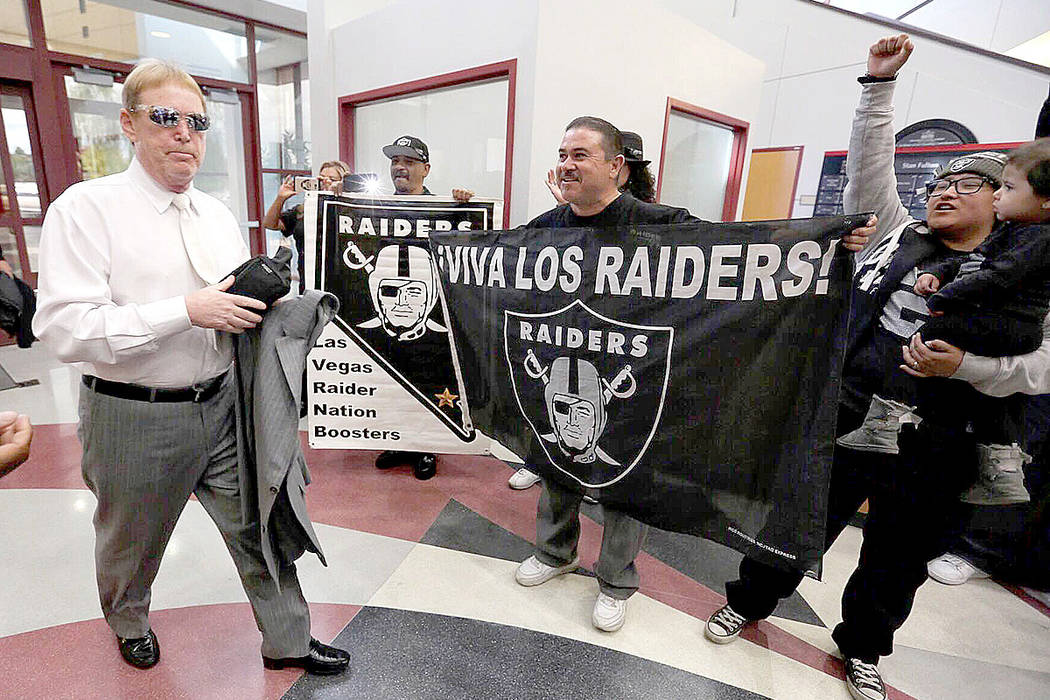Raiders owner Mark Davis walks alongside his team's supporters ahead of his meeting with the UNLV committee in Las Vegas on Thursday, April 28, 2016. (Brett Le Blanc/Las Vegas Review -Journal)