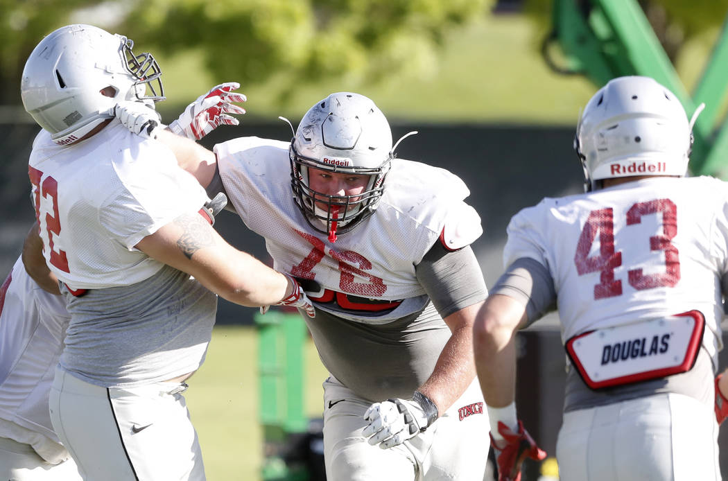 UNLV Rebels' offensive line Kyle Saxelid, center, defends Matt Brayton (72) during a team practice on Monday, 27, 2017, in Las Vegas. (Bizuayehu Tesfaye/Las Vegas Review-Journal) @bizutesfaye