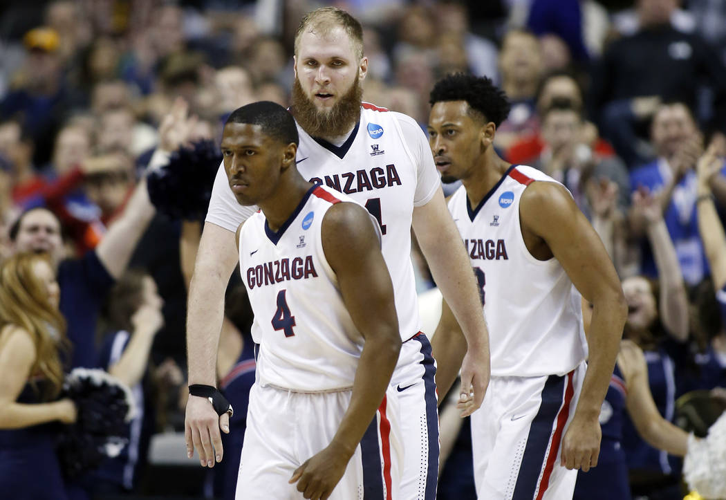 Gonzaga guard Jordan Mathews, left, Przemek Karnowski, center, and Johnathan Williams during the second half of an NCAA Tournament college basketball regional semifinal game against West Virginia  ...