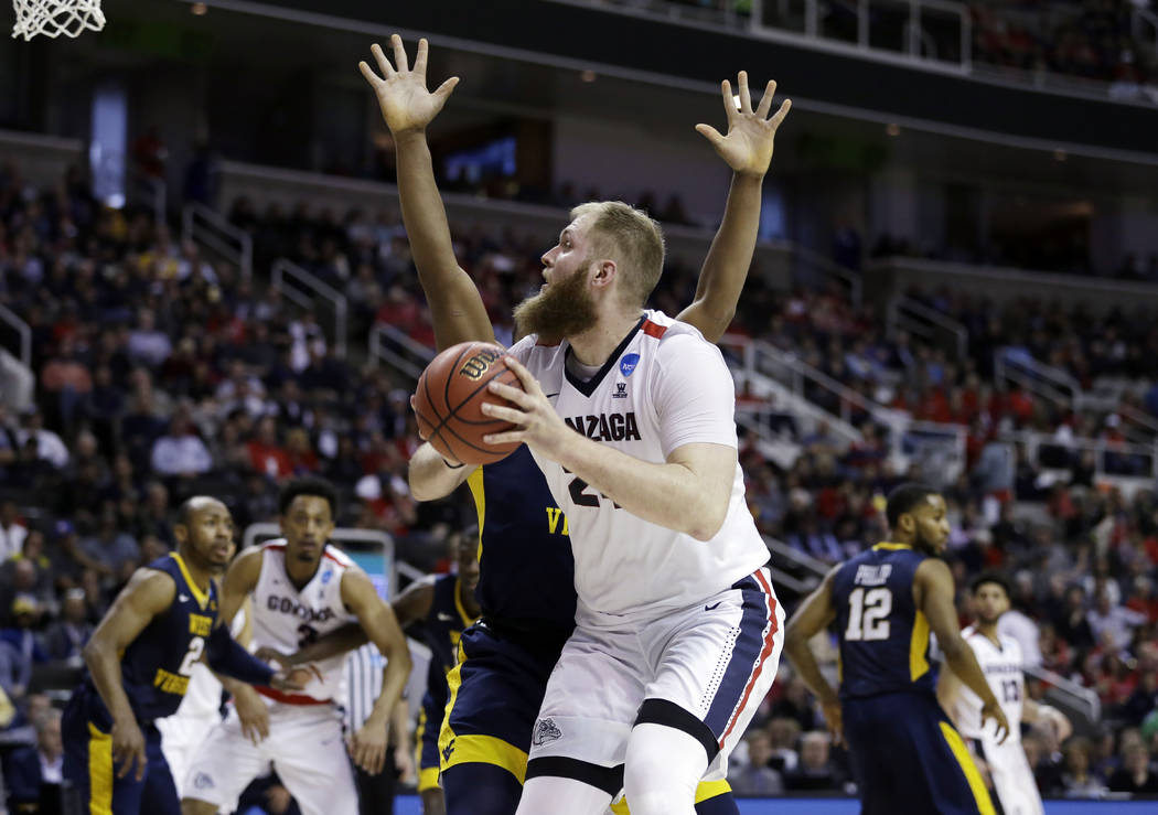 Gonzaga center Przemek Karnowski shoots against West Virginia during the second half of an NCAA Tournament college basketball regional semifinal game Thursday, March 23, 2017, in San Jose, Calif.  ...