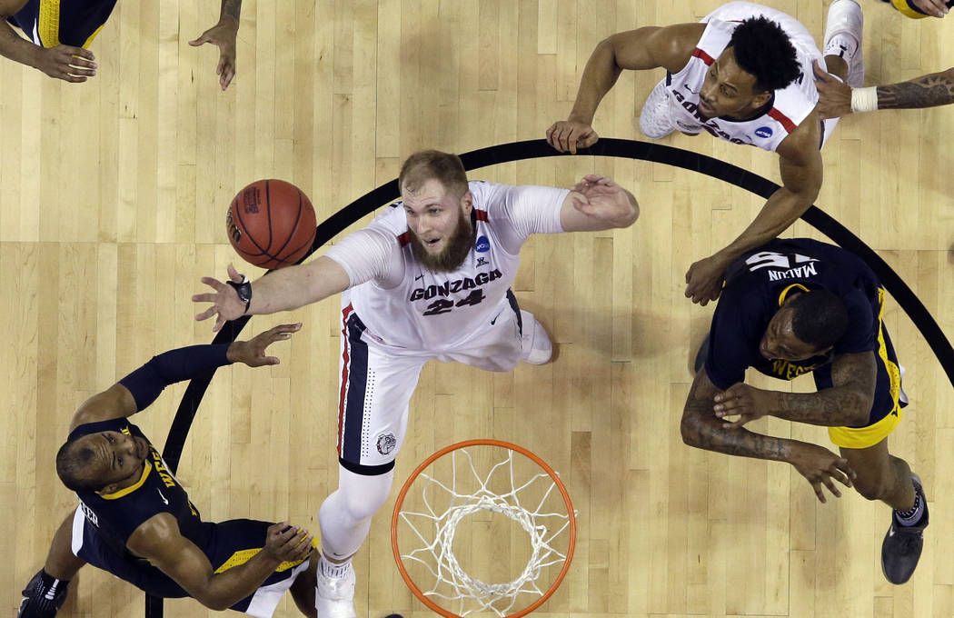 Gonzaga center Przemek Karnowski, center, grabs a rebound against West Virginia during an NCAA Tournament college basketball regional semifinal game Thursday, March 23, 2017, in San Jose, Calif. ( ...